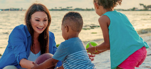 nikki fried on beach with kids