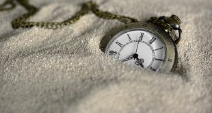 protect your assets icon pocket watch in sand